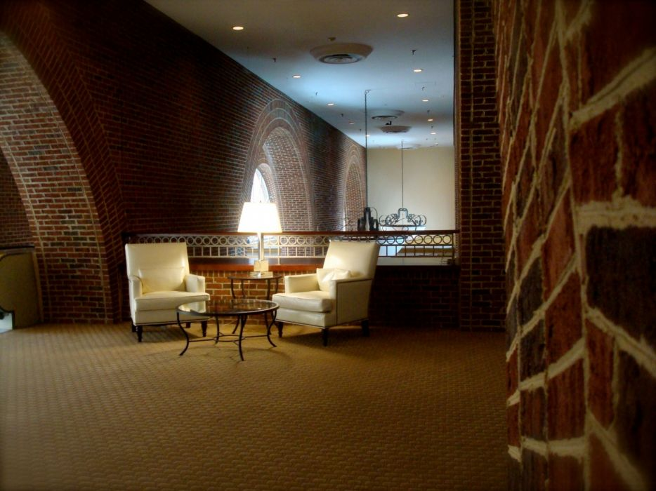tables chairs brick wall wallpaper