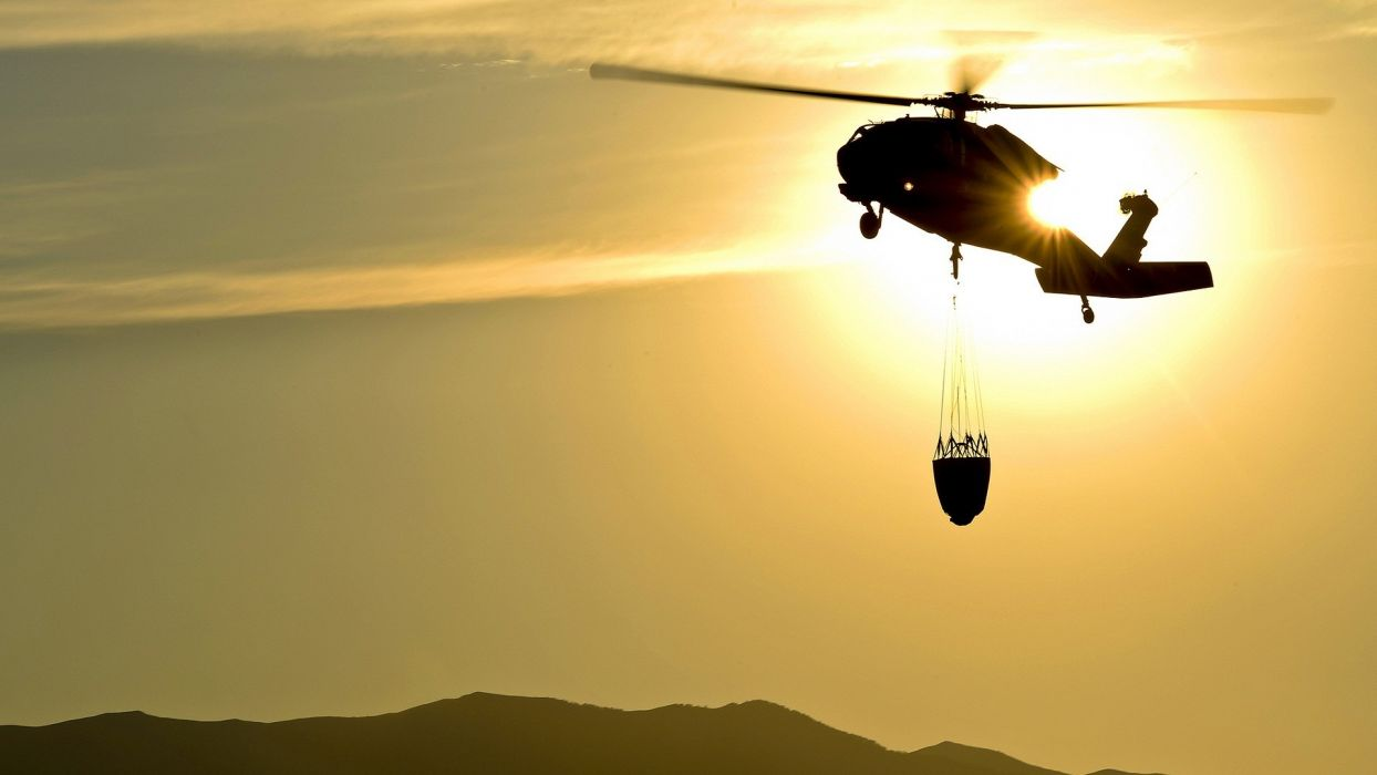 mountains Sun helicopters yellow Silhoutte wallpaper