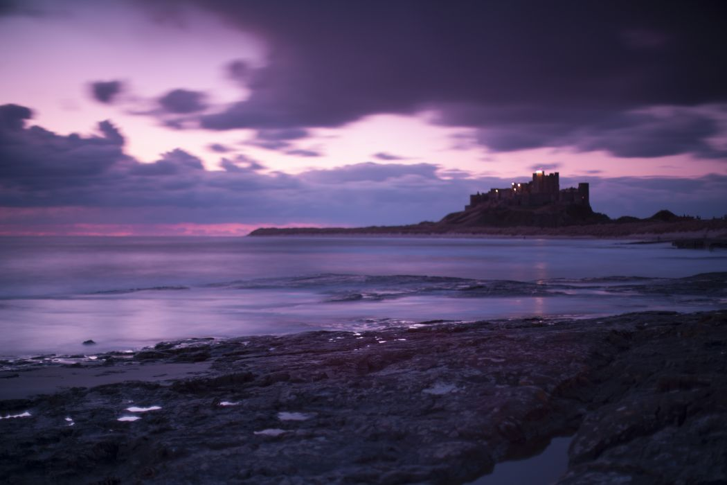 Great Britain England Bamburgh Castle sea coast evening purple sky clouds ocean wallpaper