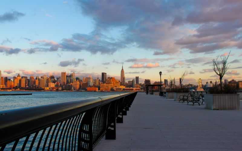 water sunset cityscapes fences New York City towns sidewalks wallpaper