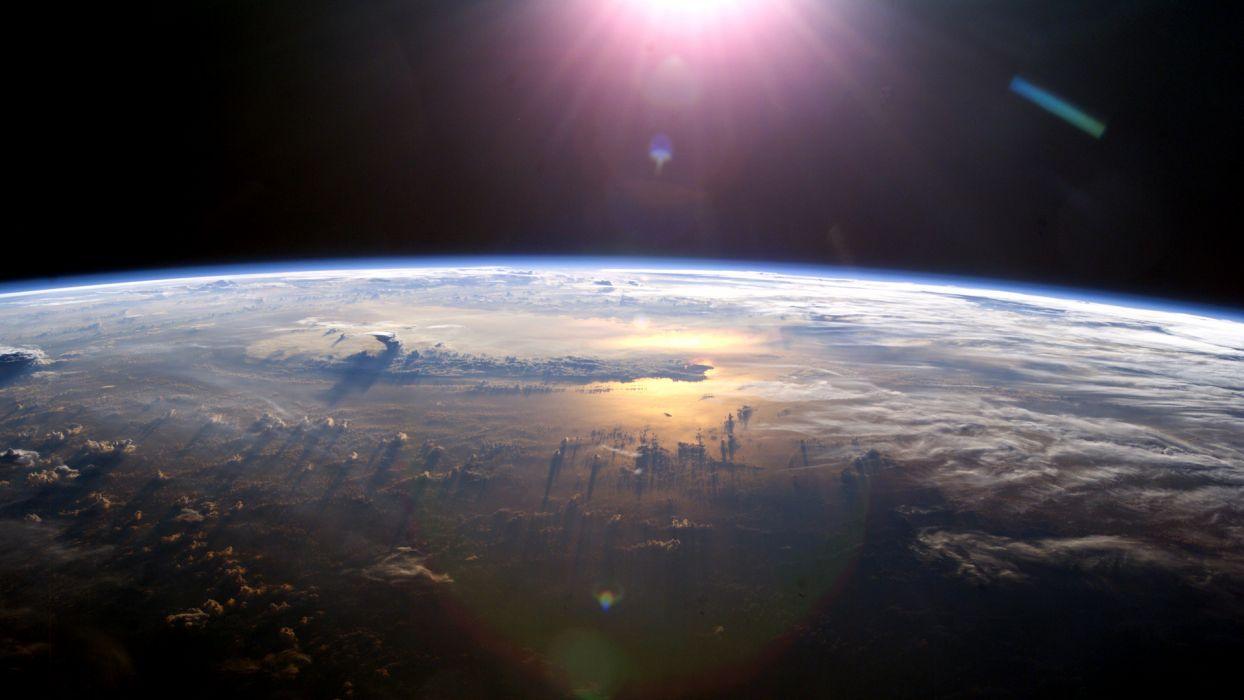 clouds Sun planets orbit wallpaper