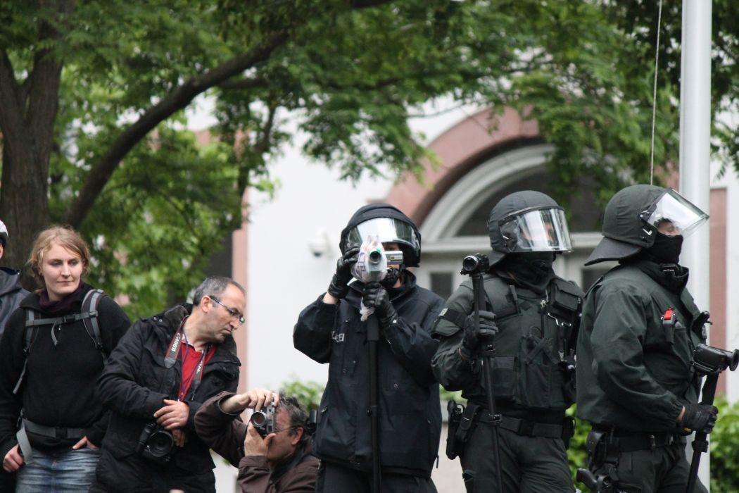 protest anarchy march crowd police camera      g wallpaper