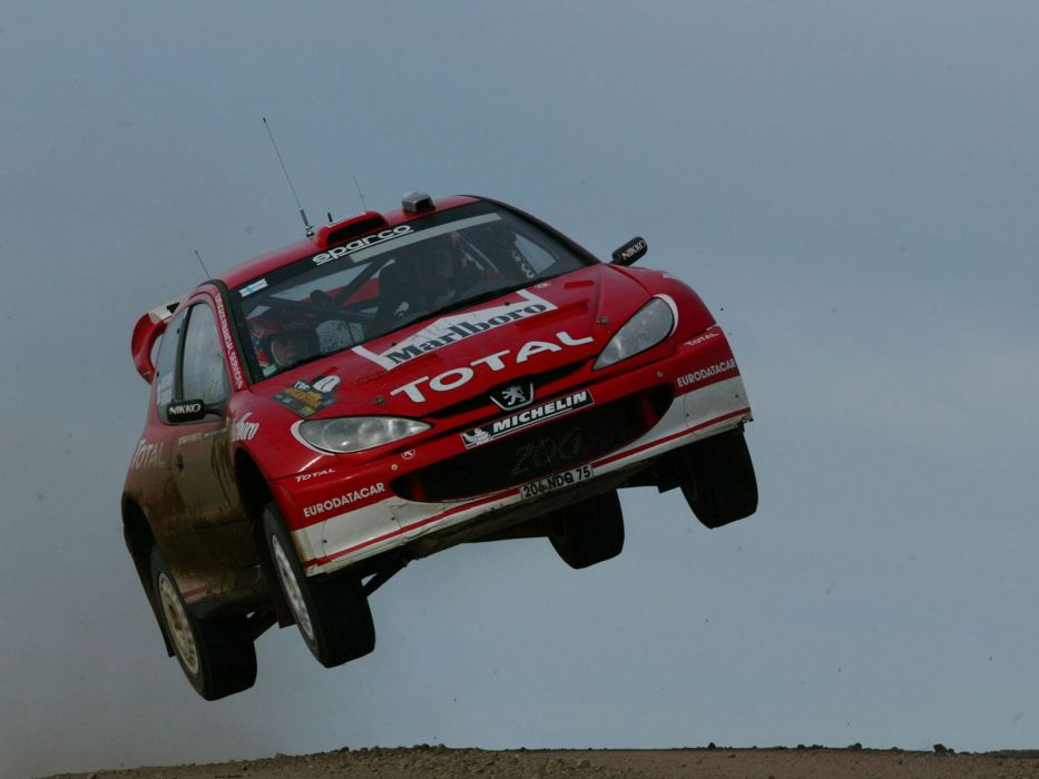 cars sports jumping rally Peugeot races wallpaper