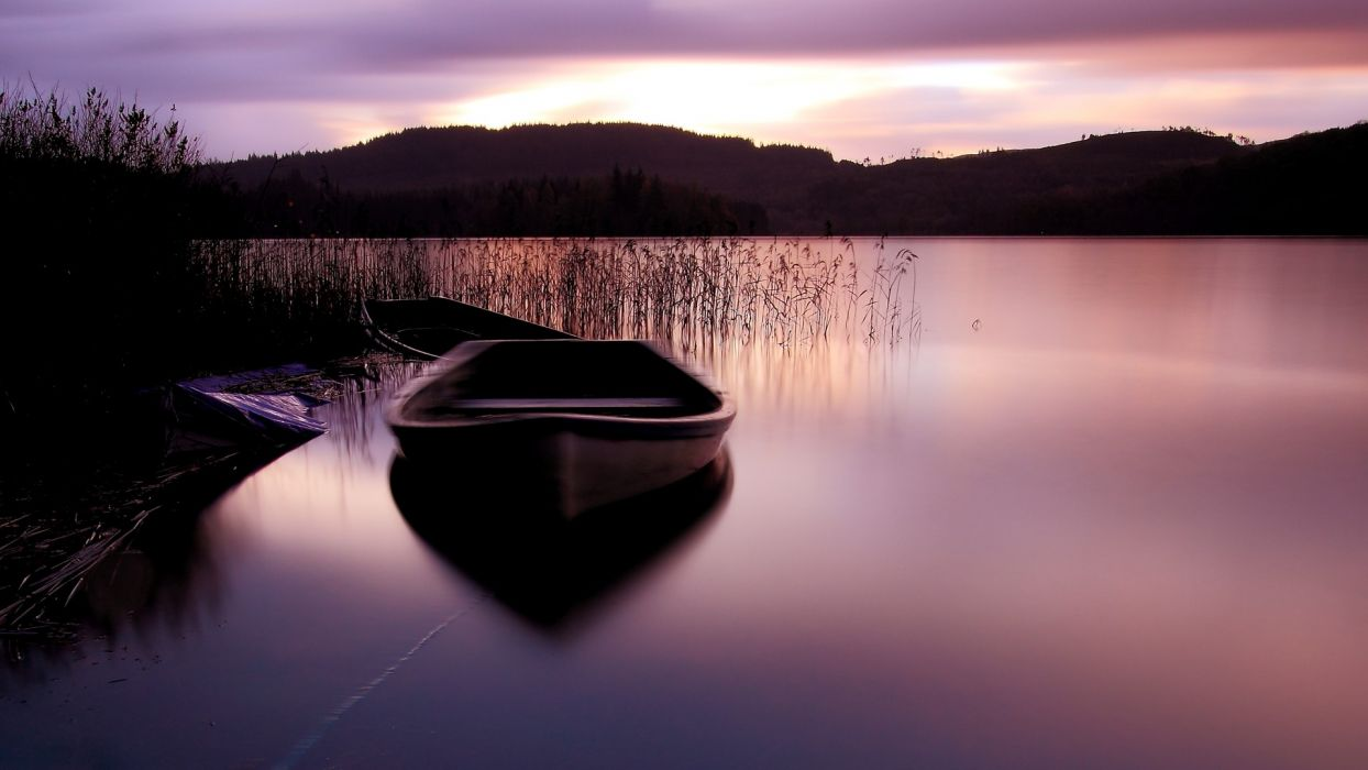 water mountains boats lakes reeds wallpaper