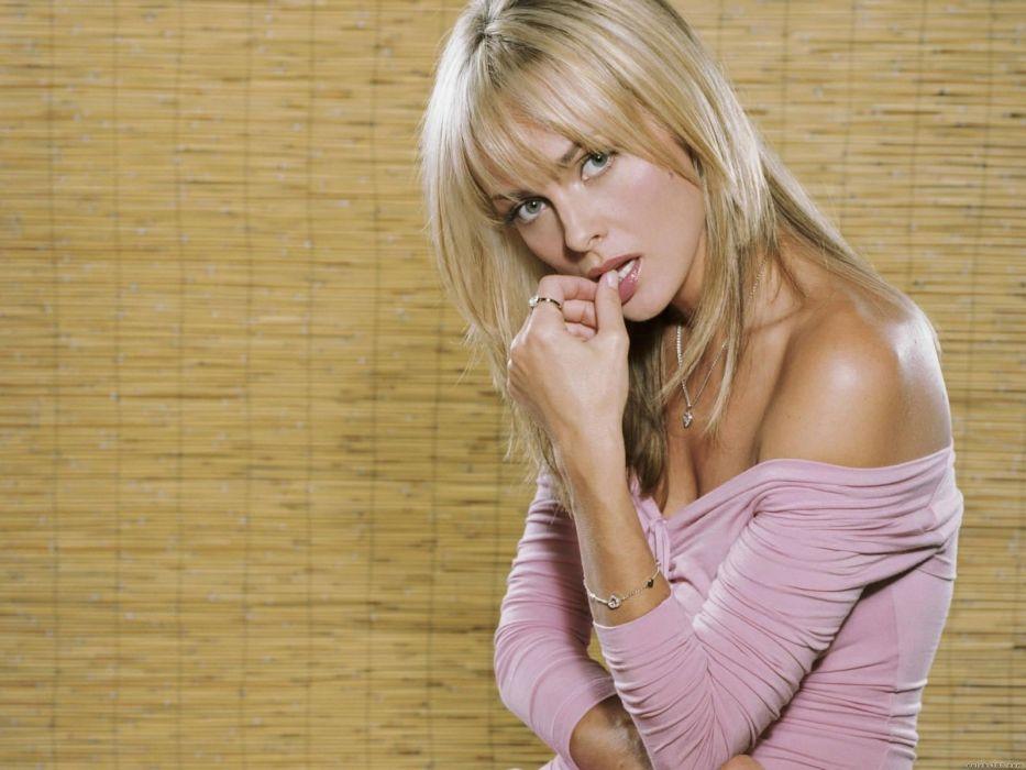 blondes women actress models Polish Izabella Scorupco fingers on lips wallpaper