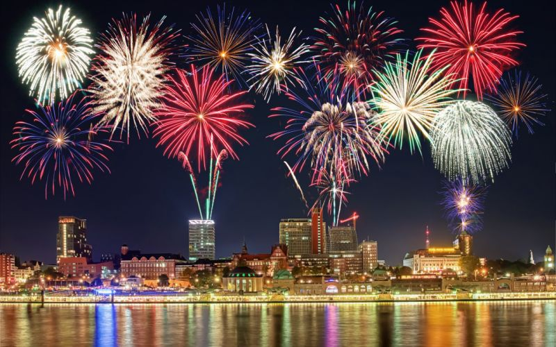 new year fireworks midnight lights building city wallpaper
