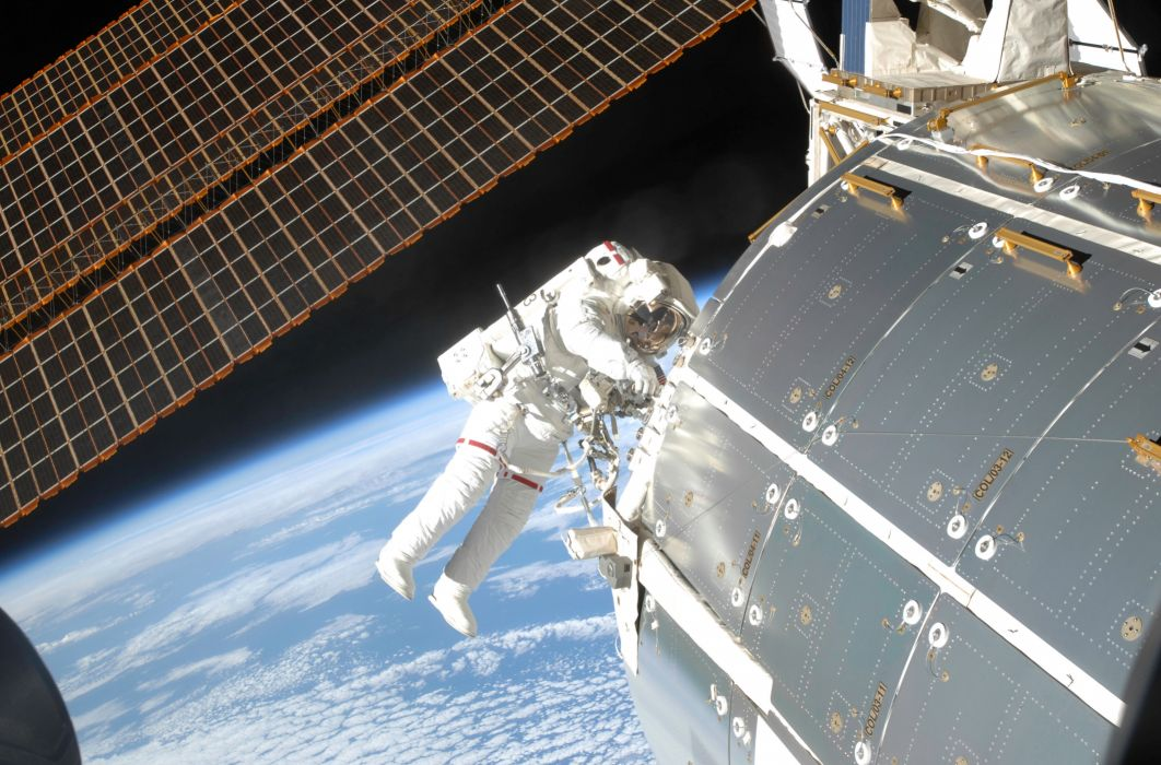 Space  ISS  the planet Earth  an Astronaut  A module  solar panels wallpaper