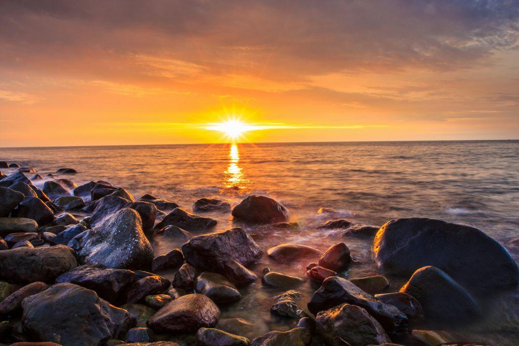Sunrises and sunsets Stones Scenery Sea Sun Nature wallpaper