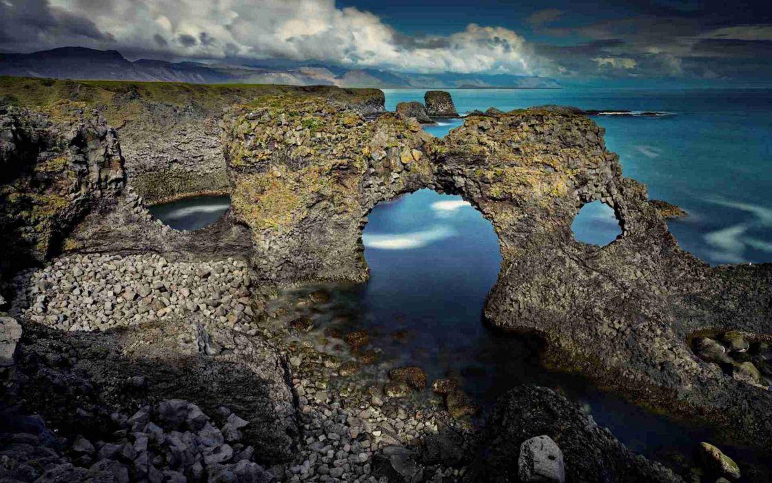 clouds coast music rocks stones hole Arch sea wallpaper