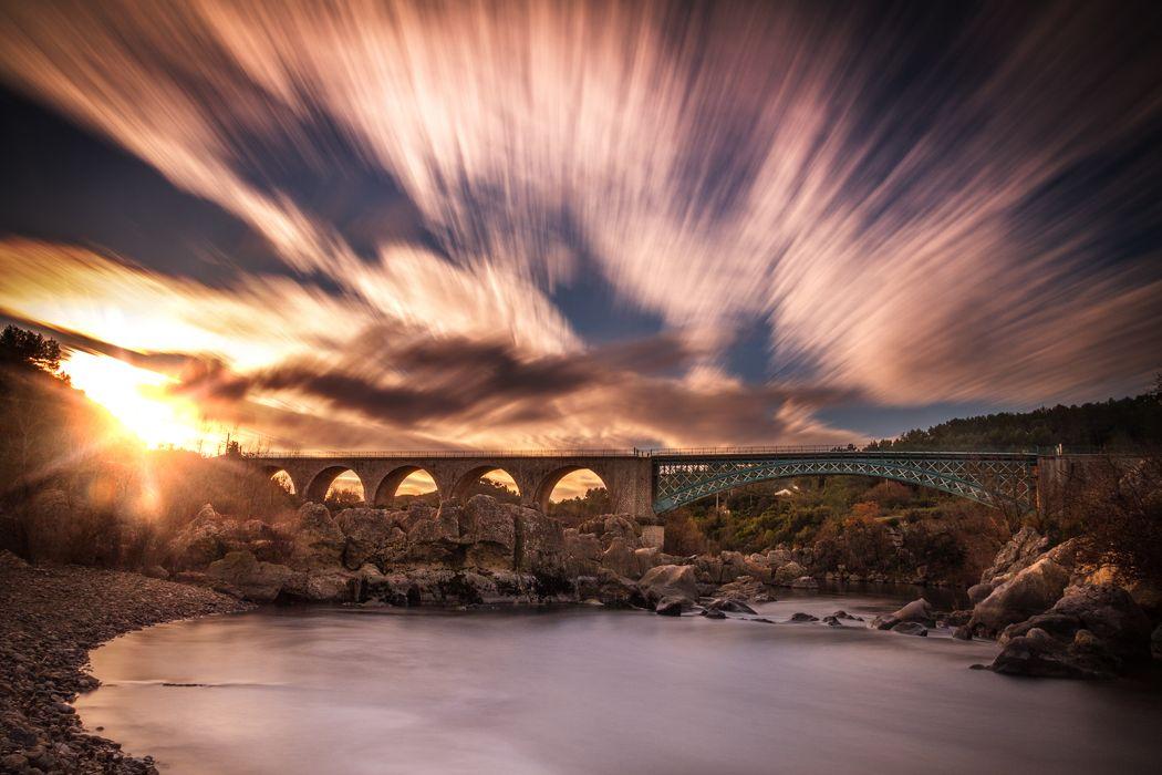 Sunset Sunlight Bridge Rocks Stones River Timelapse Clouds wallpaper