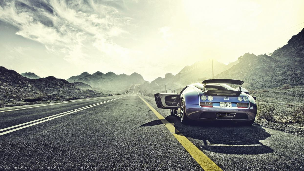 mountains clouds Sun cars Bugatti sunlight roads vehicles reflections Bugatti Veyron Grand Sport wallpaper
