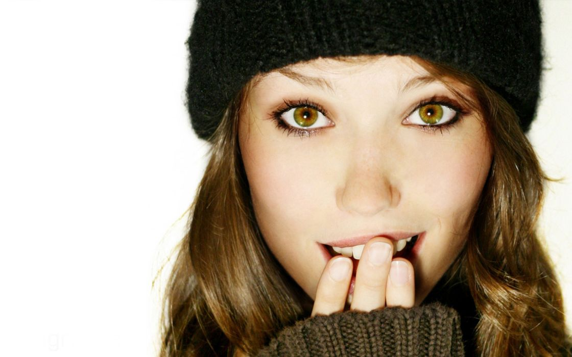 women green eyes smiling faces white background hands on face caps wallpaper