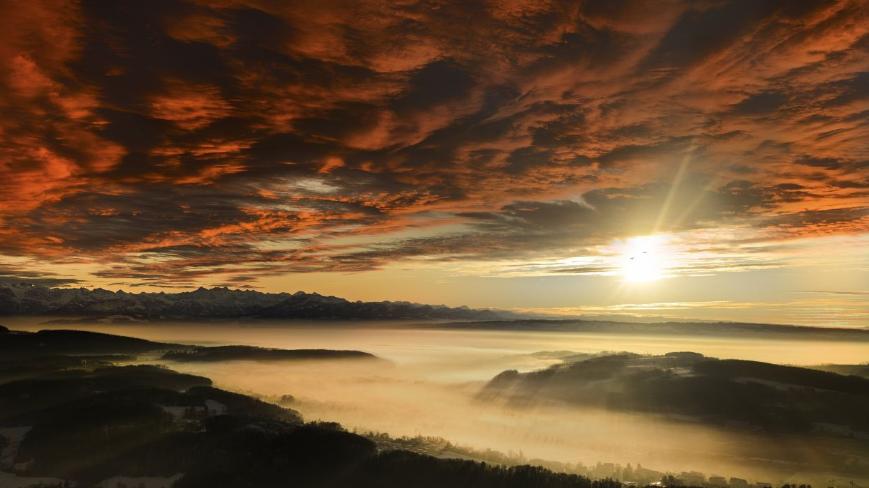 sunset sunrise clouds fog mountains sun wallpaper