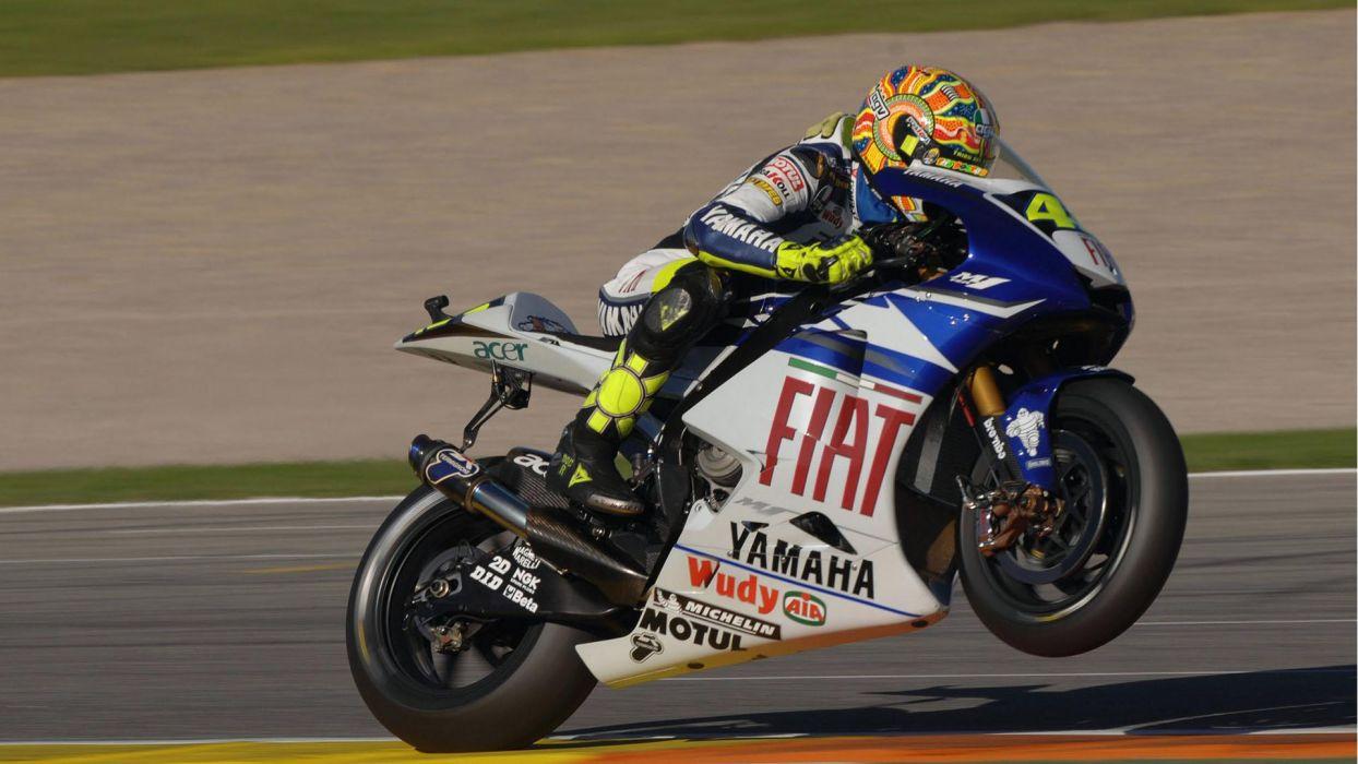 bikes vehicles Moto GP motorbikes wheelie Valentino Rossi wallpaper