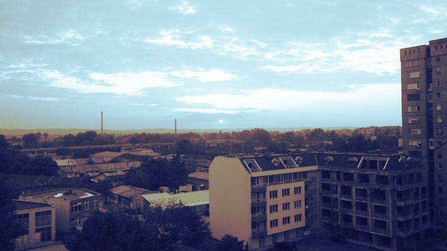 sunset blue buildings calm skies wallpaper