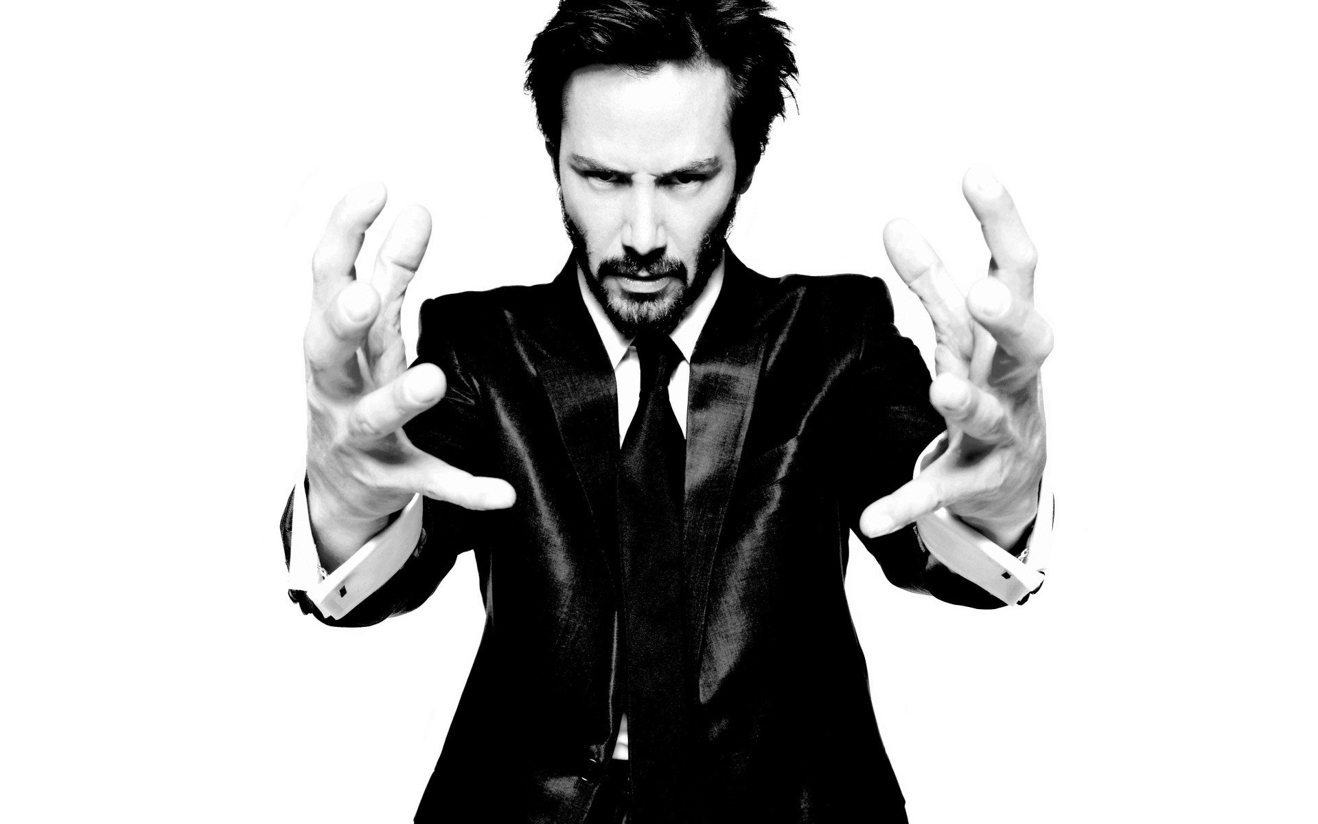 Black and white suit hands men celebrity keanu reeves for Black and white pictures of celebrities