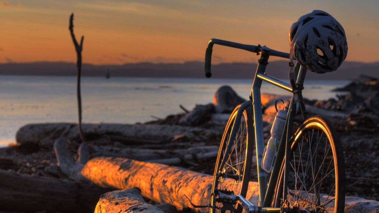 bicycles motorbikes sea wallpaper