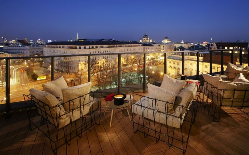 cityscapes architecture balcony buildings city lights chairs Vienna wallpaper