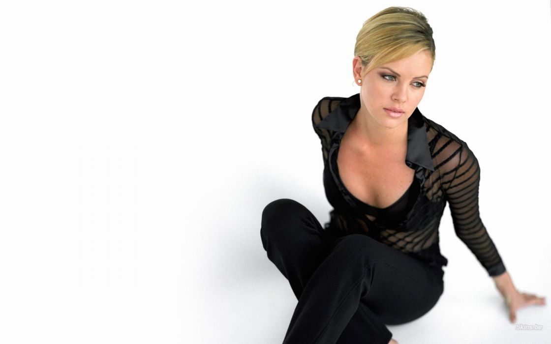 women actress Charlize Theron simple background wallpaper