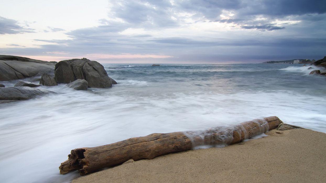 Beach Log Ocean Rocks Stones wallpaper