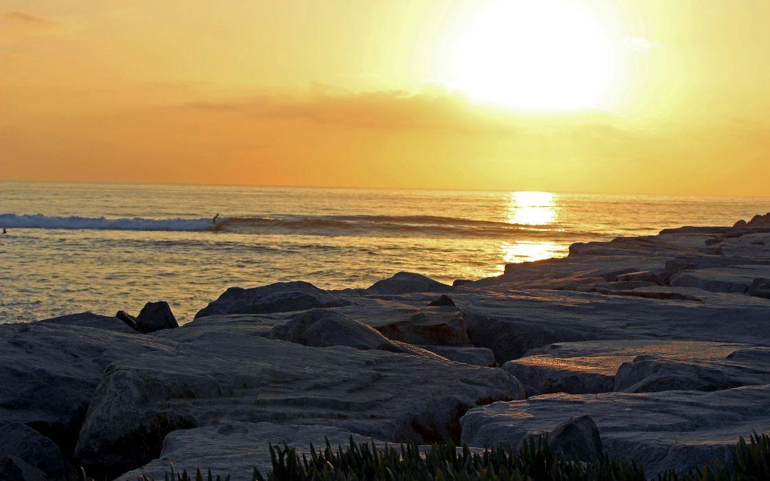 Sunlight Rocks Stones Ocean wallpaper