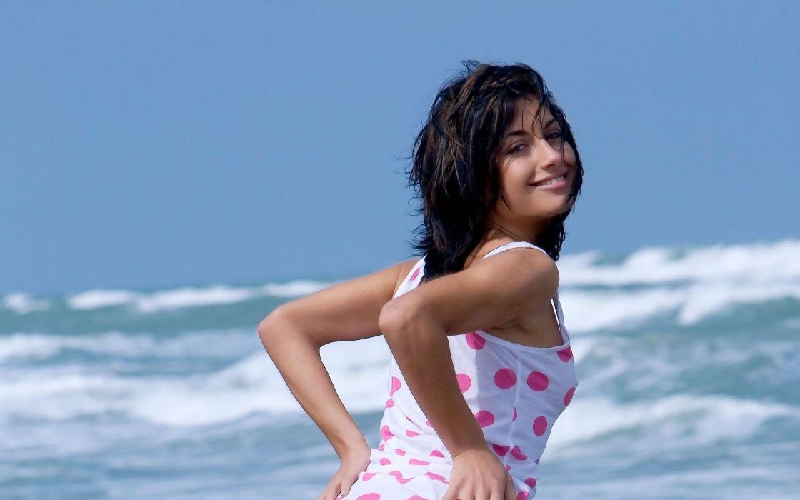 women models outdoors Femjoy magazine smiling polka dots white dress looking back hands on hips black hair Laila (Femjoy) beaches wallpaper