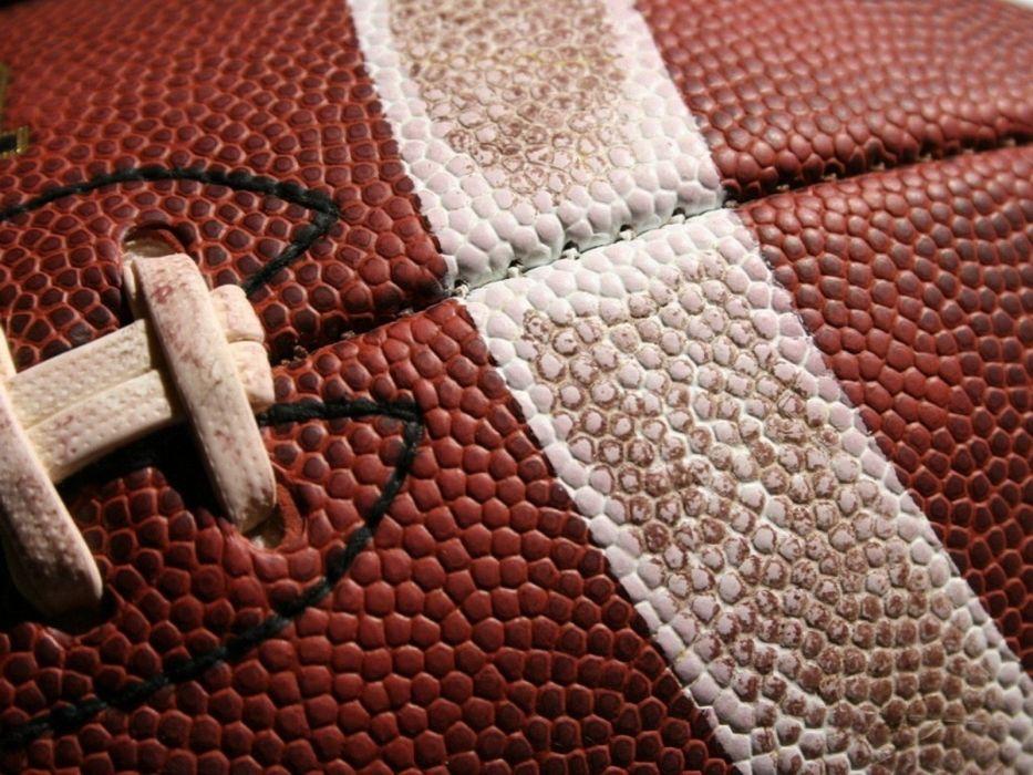 close-up balls American Football wallpaper