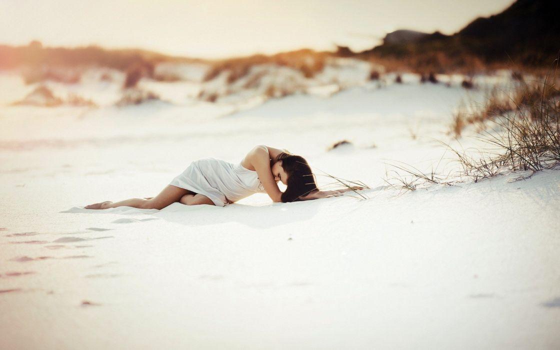 women lying down white dress white sand wallpaper