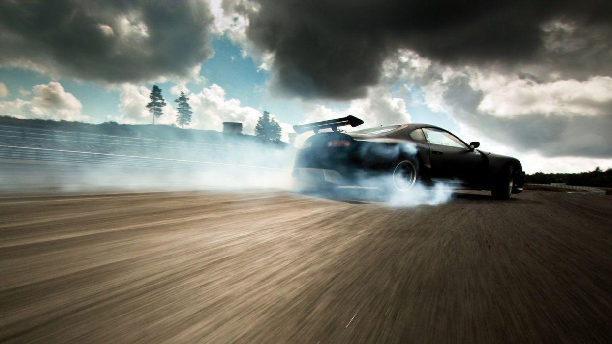 clouds cars Toyota Supra drifting wallpaper