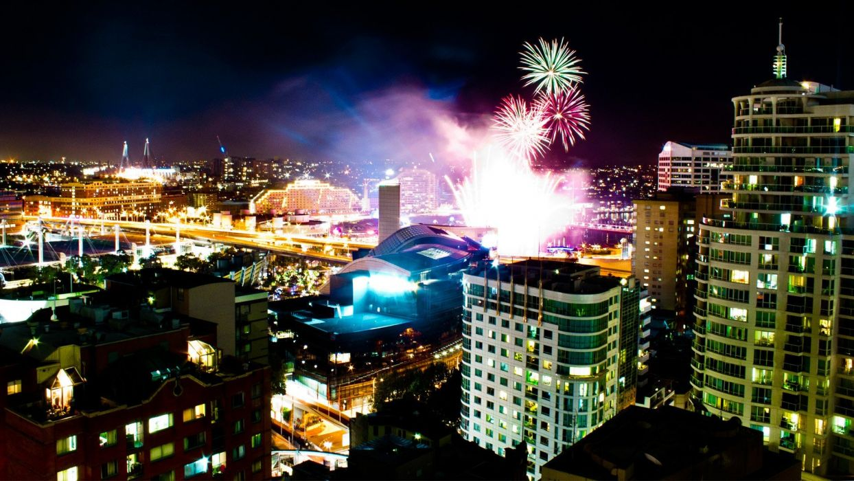 cityscapes night lights multicolor wall explosions fireworks buildings Sydney city lights Australia Australian nighttime city skyline explosion citylife colors wallpaper