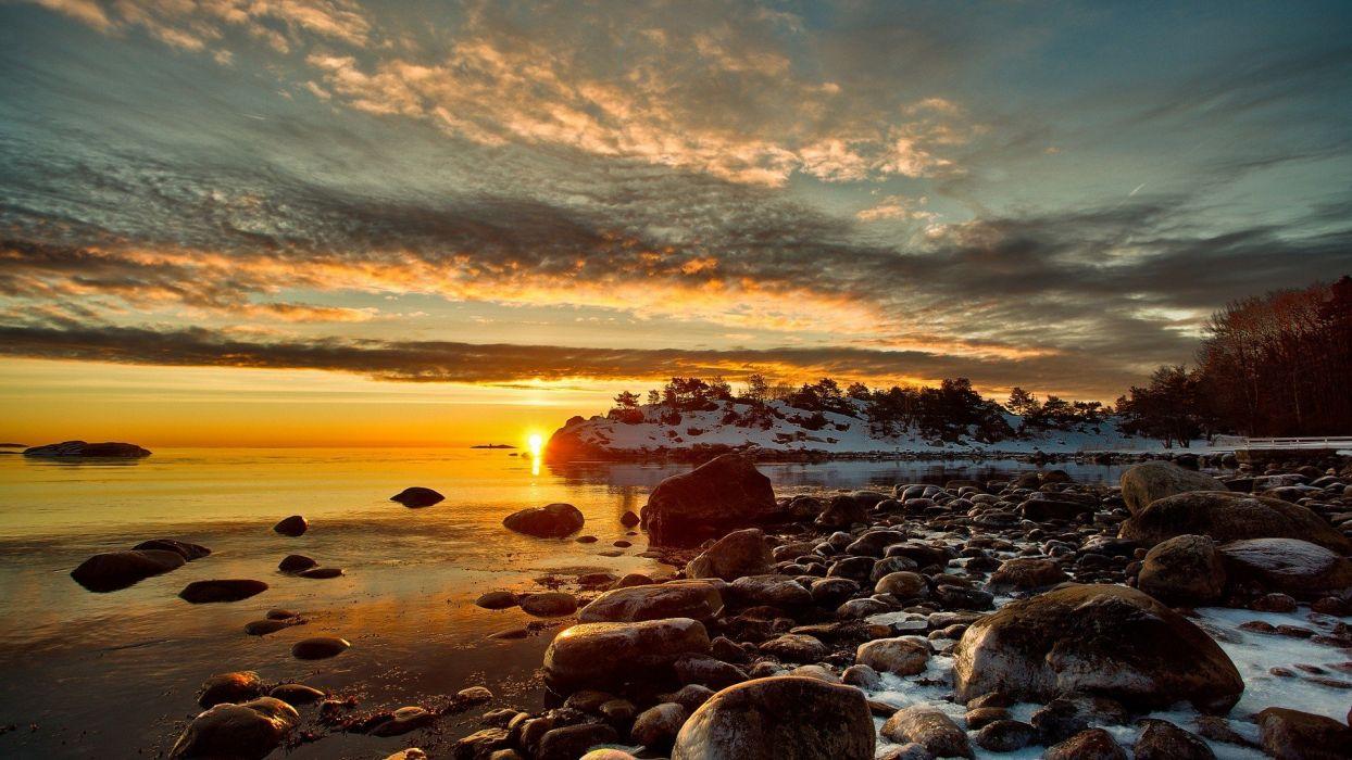 water sunset clouds winter snow stones wallpaper