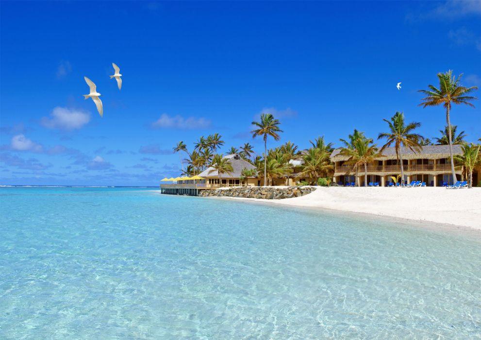 bungalows sand beach birds sky sea wallpaper