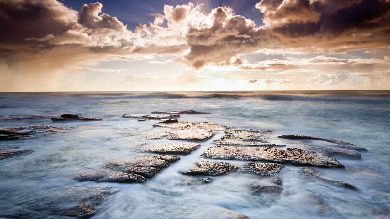 sunset ocean landscapes nature Sun rocks skyscapes land sea wallpaper