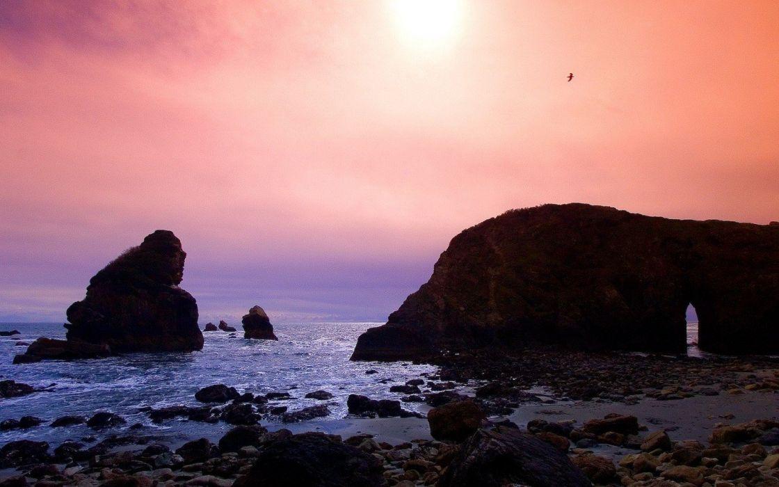 sunset rocks shore wallpaper