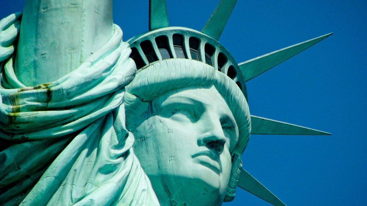 USA New York City Statue of Liberty Liberty Statue blue skies wallpaper