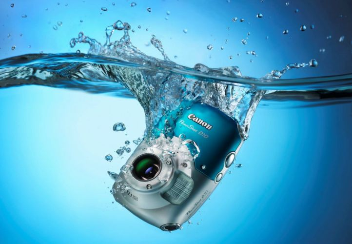 Digital camera Canon PowerShot D10 water drops spray background blue wallpaper