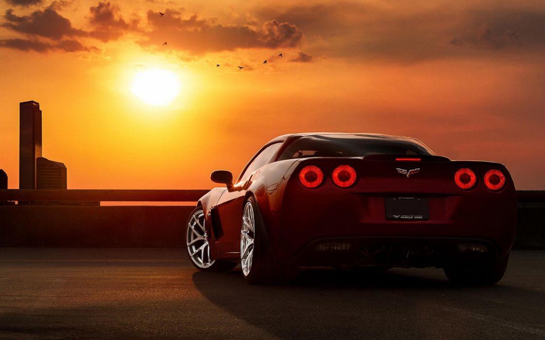 clouds supercars Chevrolet Corvette red cars Chevrolet Corvette Z06 cities taillights wallpaper
