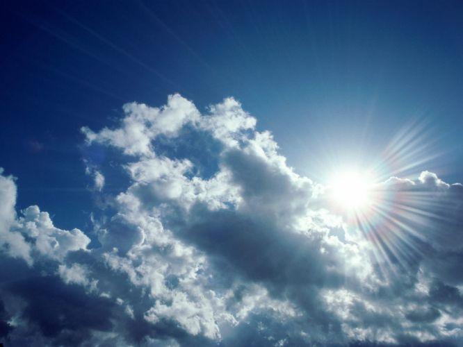 clouds Sun skyscapes sun flare wallpaper