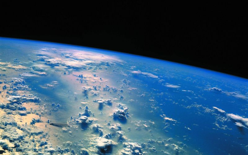 clouds outer space stars Earth wallpaper