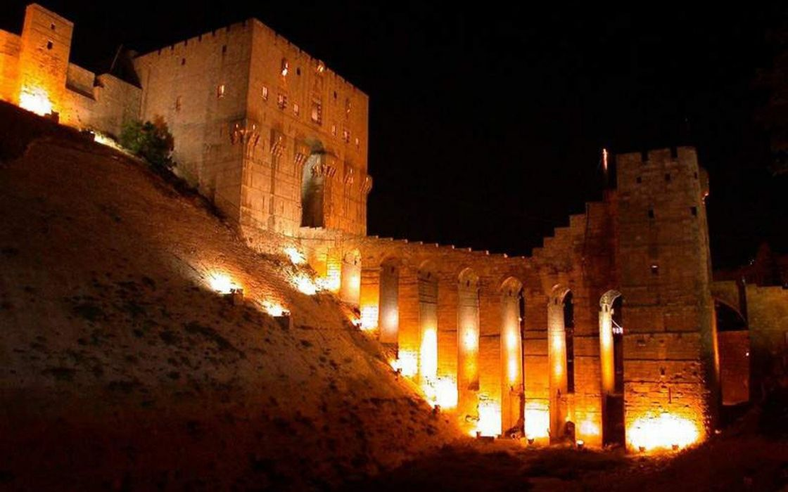 light night stones buildings castle Syria man-made wallpaper