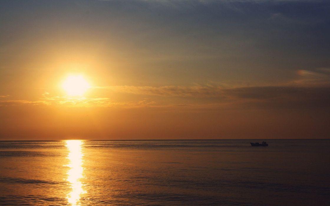 sunset Sun boats sea wallpaper