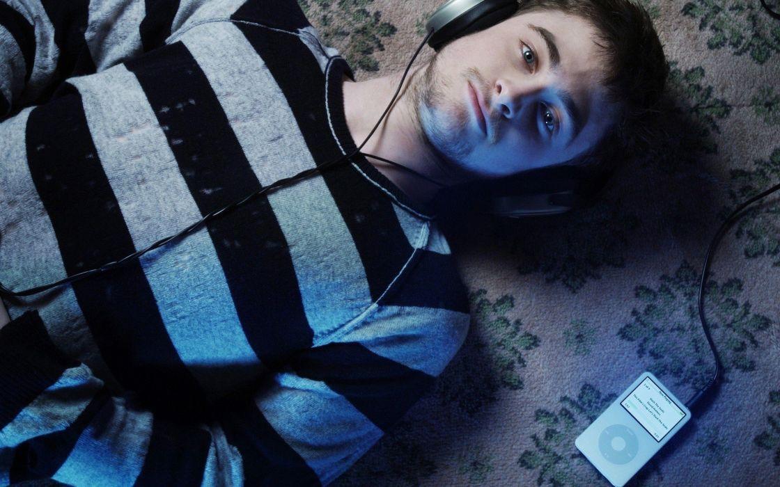 headphones music blue eyes iPod men carpet lying down Daniel Radcliffe striped clothing wallpaper