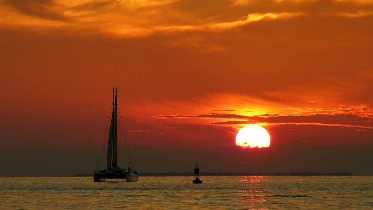 sunset ocean clouds landscapes Sun boats vehicles wallpaper