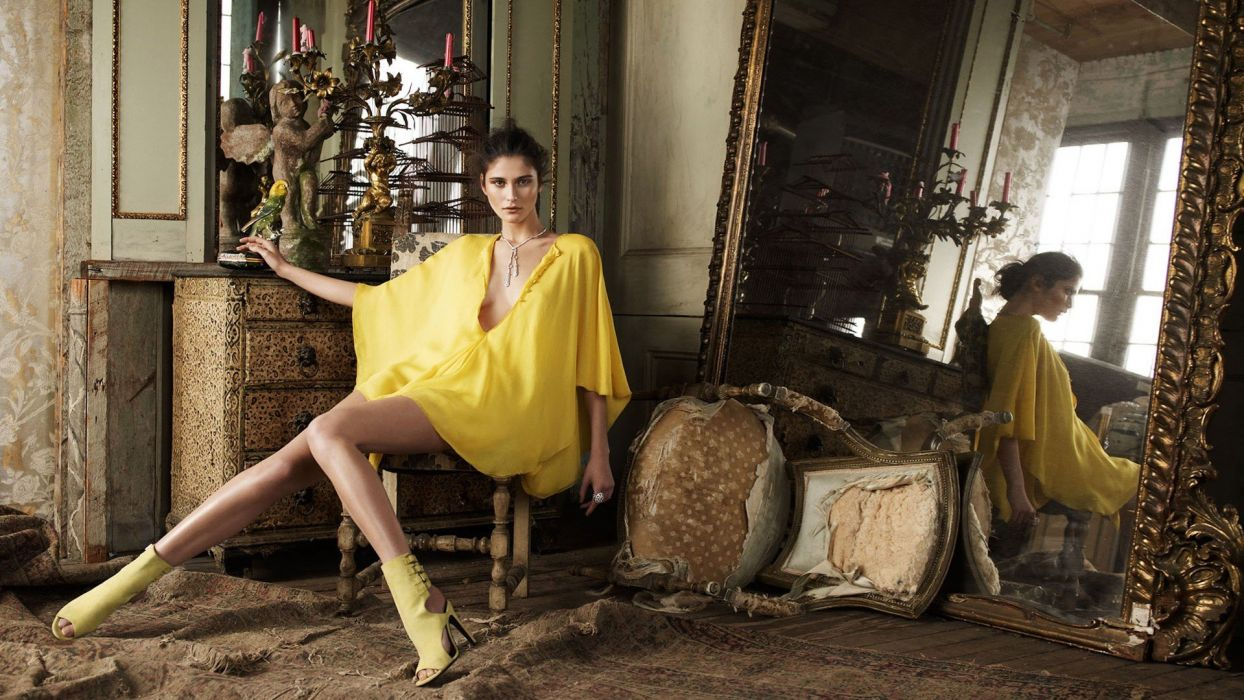 brunettes women mirrors high heels chairs yellow dress wallpaper