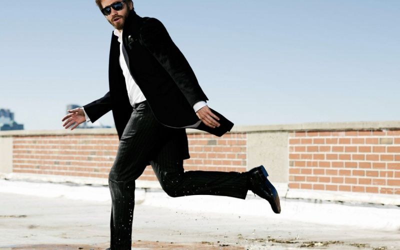 men sunglasses actors Jake Gyllenhaal running brick wall black jacket wallpaper