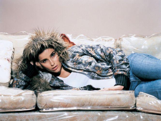 brunettes women jeans blue eyes Nelly Furtado lying down wallpaper