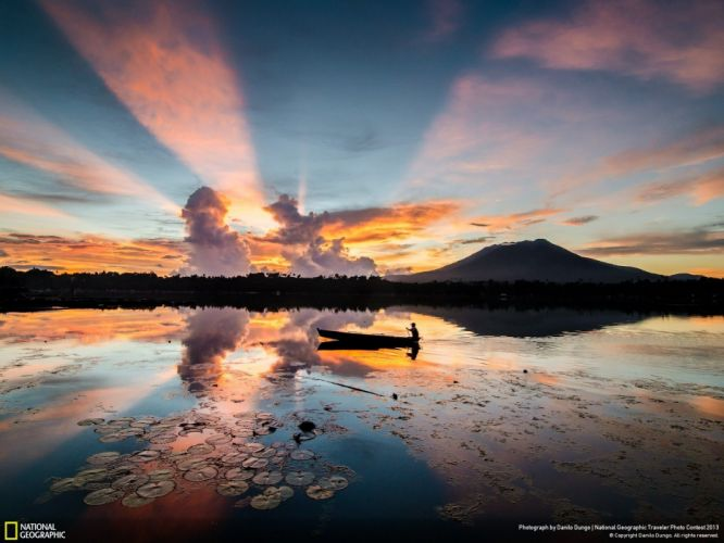 sunrise mountains nature silhouettes Philippines National Geographic boats lakes lily pads reflections wallpaper