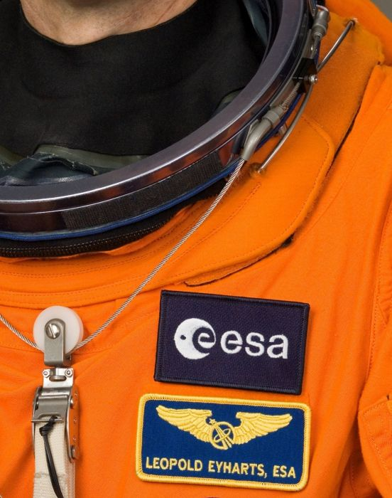 Close-up of spacesuit with wings and ESA patch esa europe space wallpaper