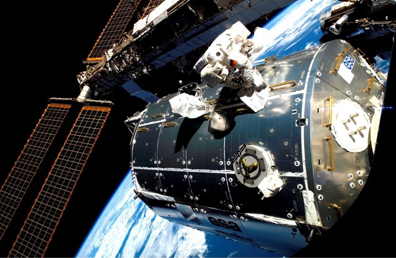 ESA astronaut Hans Schlegel outside space station 1842x1200 wallpaper