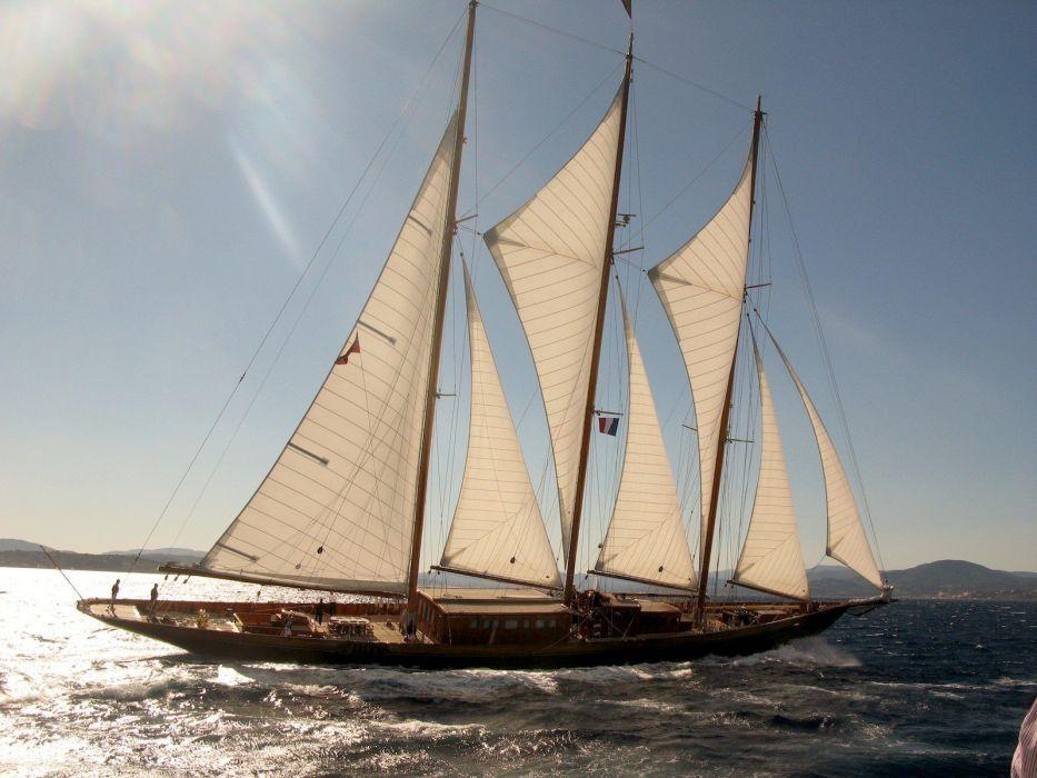 Sun boats vehicles sailboats adventure sea wallpaper